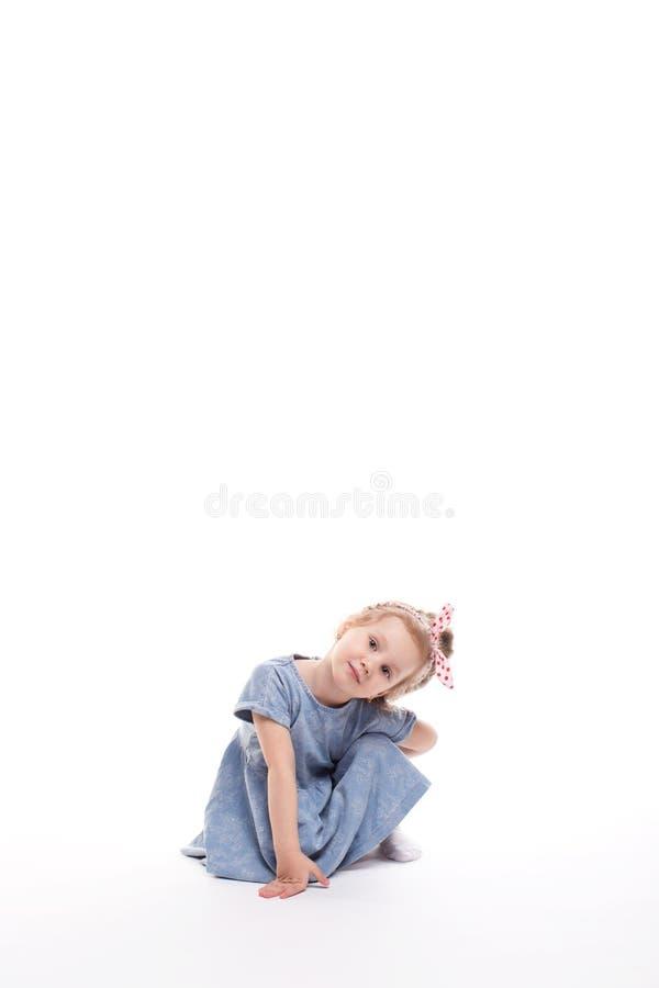 Little girl posing on a white. stock photo