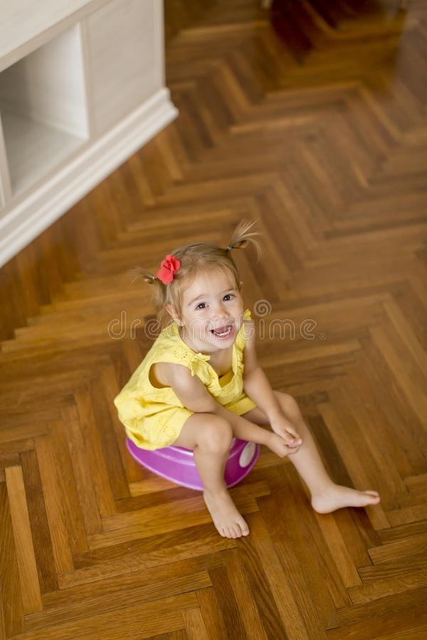Little girl on potty stock photo