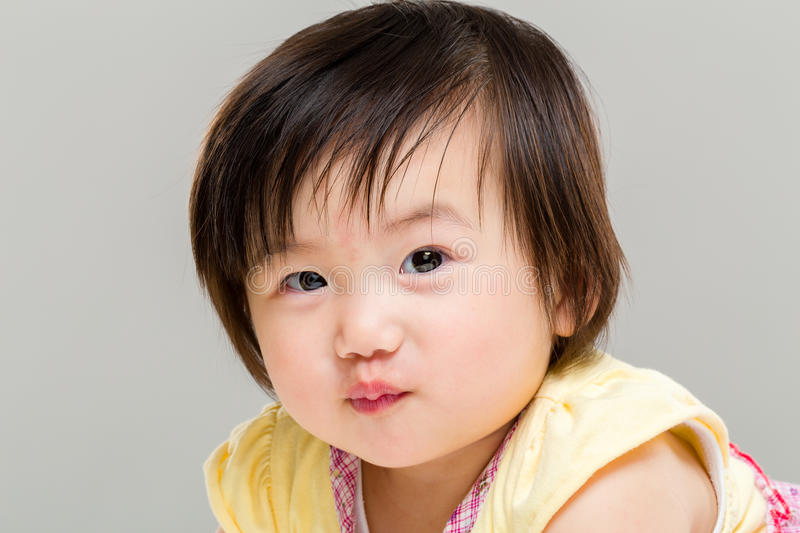Little girl pouting lip stock image