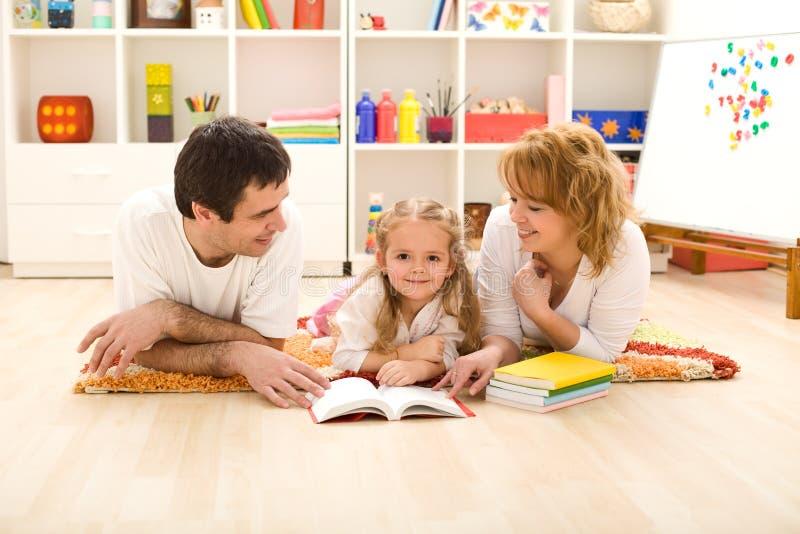 Little girl practice reading stock photo