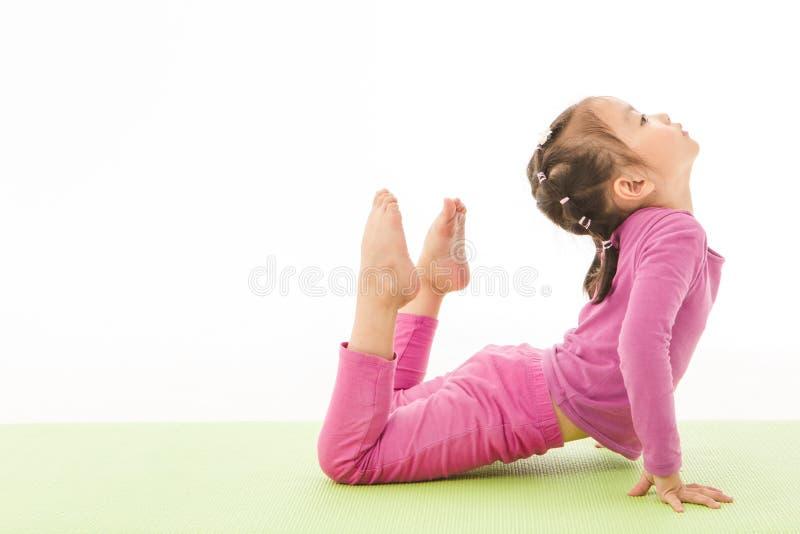 Little girl practice yoga royalty free stock image