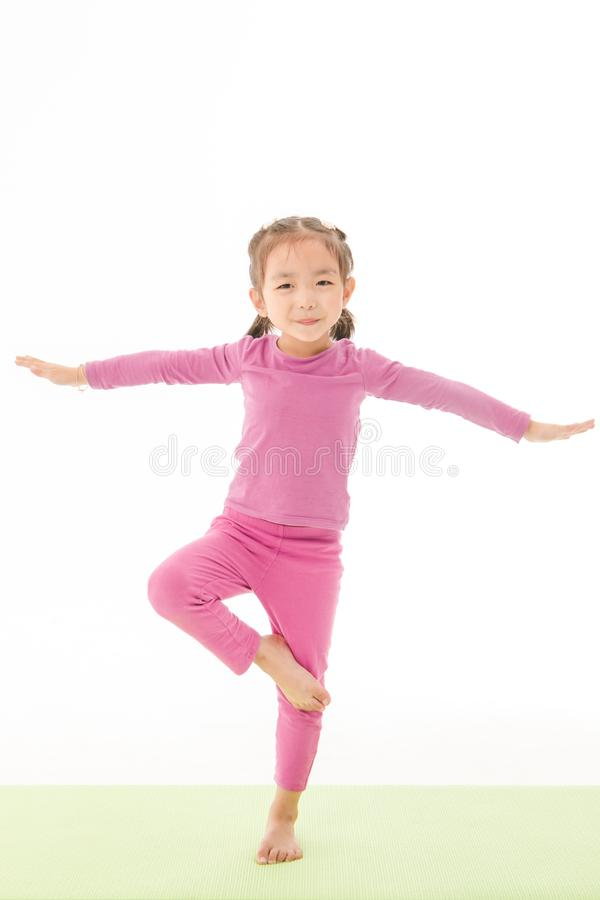 Little girl practice yoga stock images