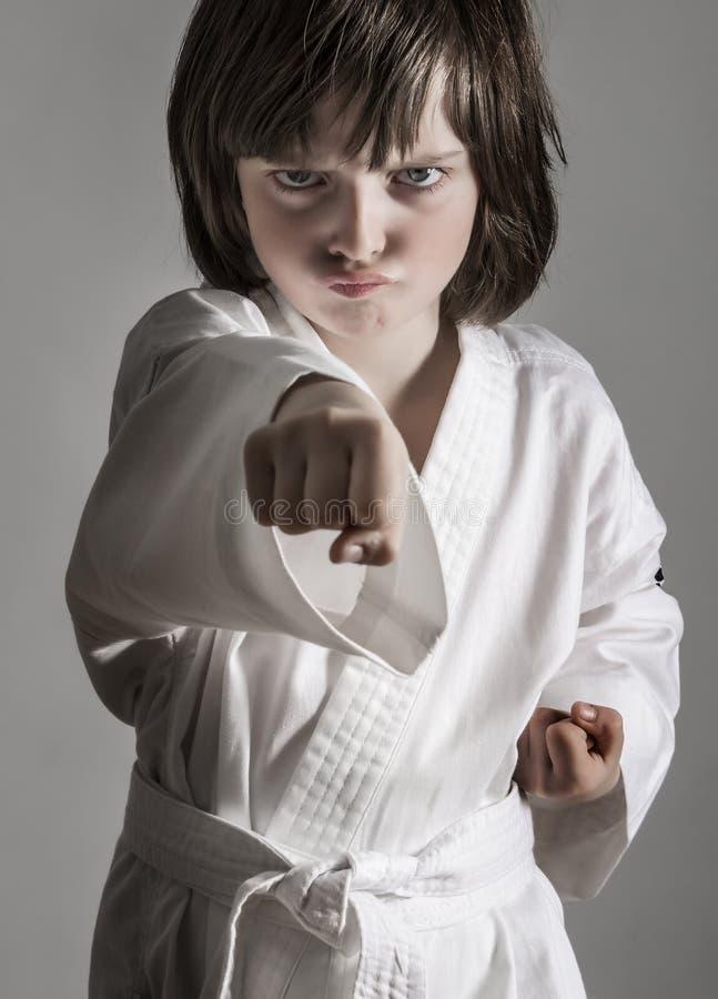 Little girl practicing karate stock image