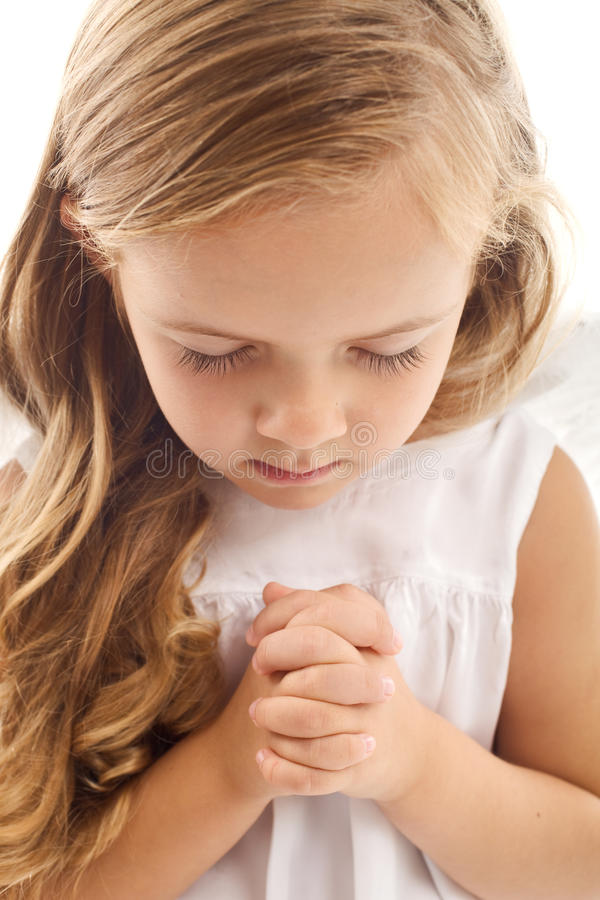 Little girl praying stock photos