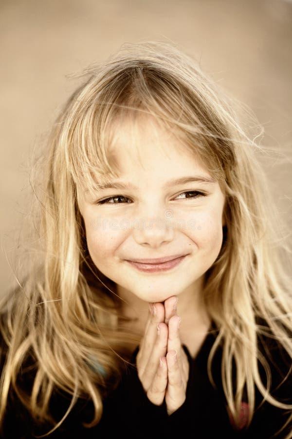 Little girl praying stock image