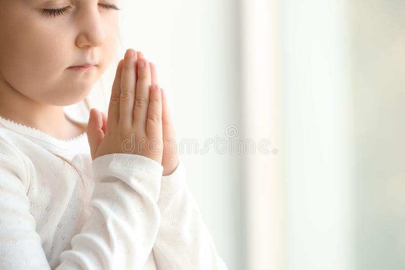 Little girl praying at home royalty free stock images