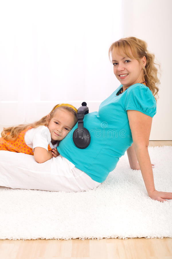 Little girl and pregnant woman together royalty free stock photos