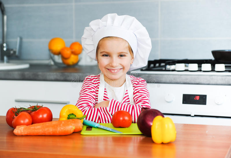 Little girl preparing healthy food stock photo