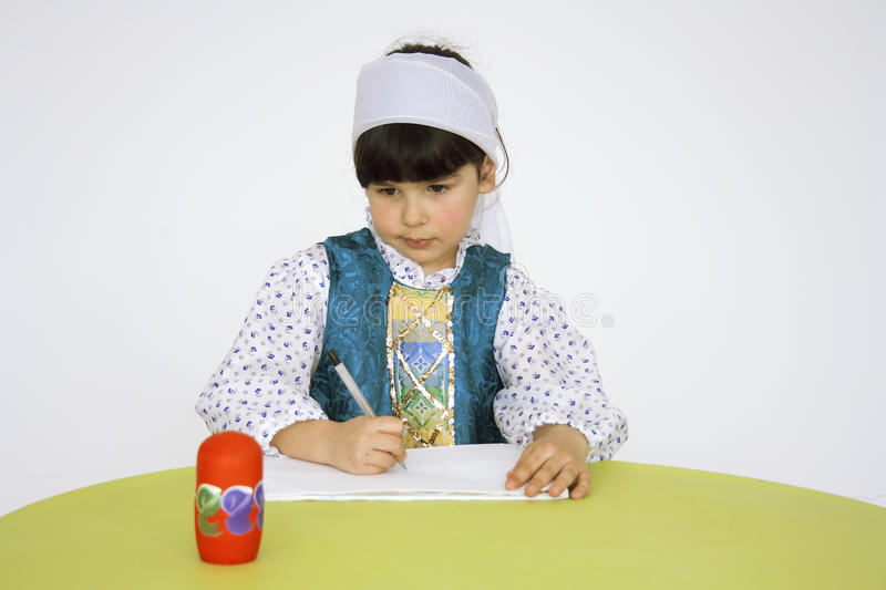 A little girl, a preschooler, learning to draw royalty free stock photos