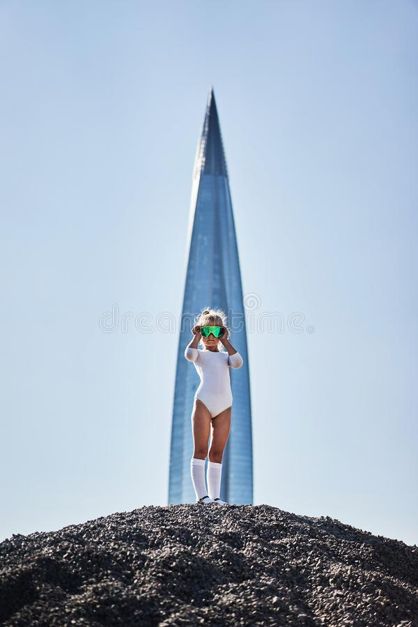 Little girl present day equipment looking white golfs. Technic blue science study kid contemporary up sky stock image