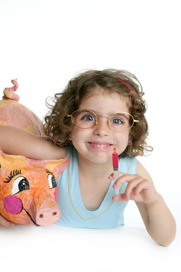 Little girl pretending be veterinary with a pig royalty free stock photography