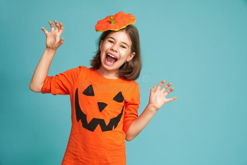 Little girl in pumpkin costume royalty free stock images
