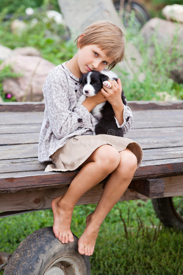 Little girl with the puppy stock photography