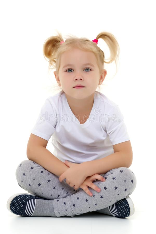 A little girl in a pure white T-shirt. royalty free stock photos
