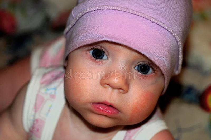 The little girl in the purple hat stock photo