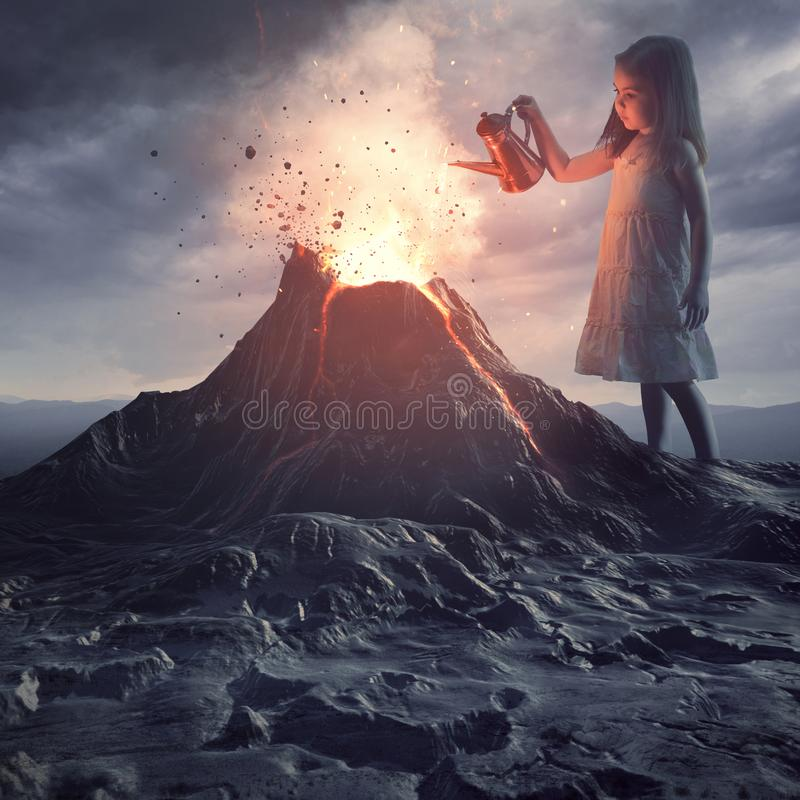 Little girl putting out volcano. A little girl stands above a volano and pours water to put out the flames royalty free stock images