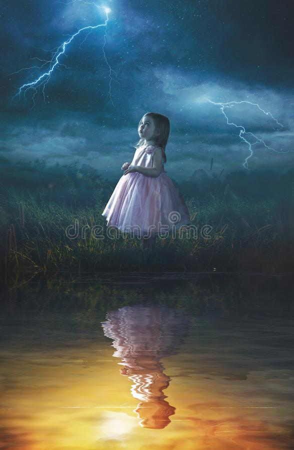 Little girl in rain storm. A little girl looking up at a rain storm while her reflection is in warm sunlight royalty free stock photo