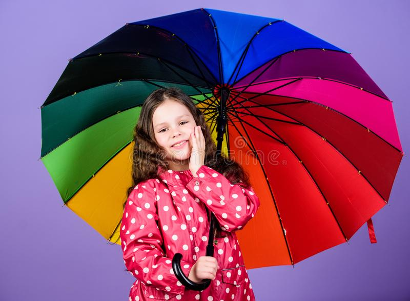 Little girl in raincoat. happy little girl with colorful umbrella. rain protection. Rainbow. autumn fashion. cheerful royalty free stock images