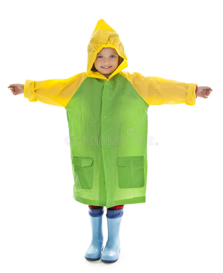 Little girl with raincoat and rubber boots stock images