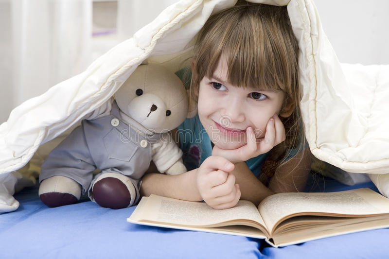 Download Little Girl Reading A Book Lying In Bed Stock Image - Image: 11608683
