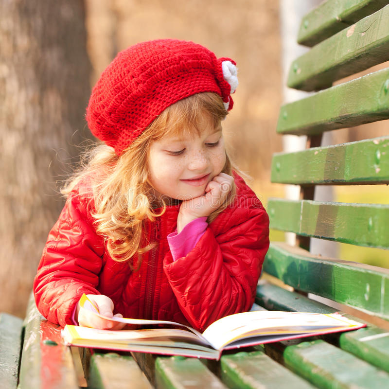 Download Little Girl Reading A Book  In The Park. Stock Photo - Image: 34904020