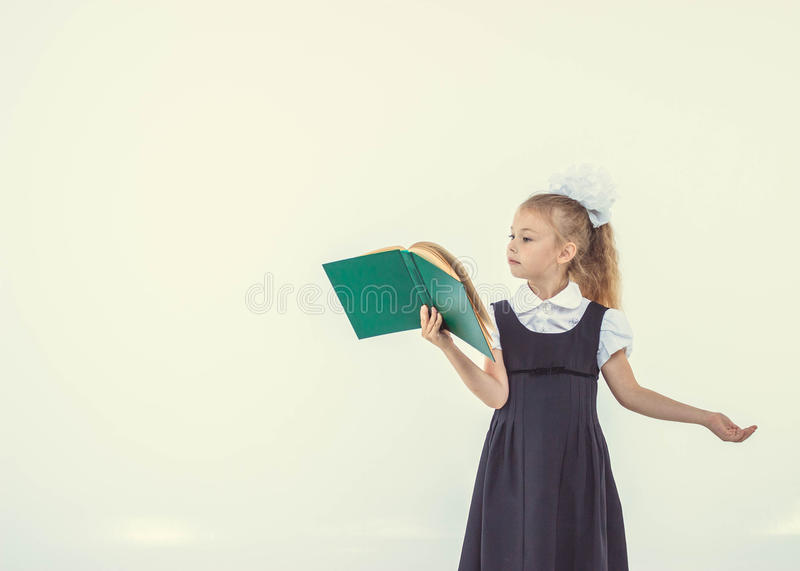 Little girl reading book, preparing for school royalty free stock image