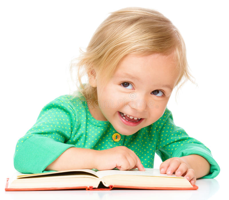 Little girl is reading her book. Isolated over white stock photos