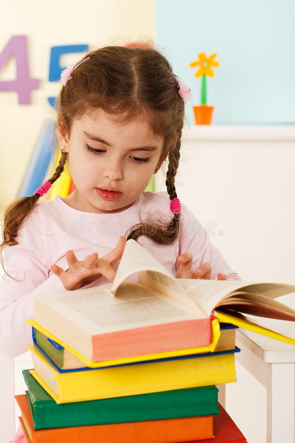Little girl reads royalty free stock images