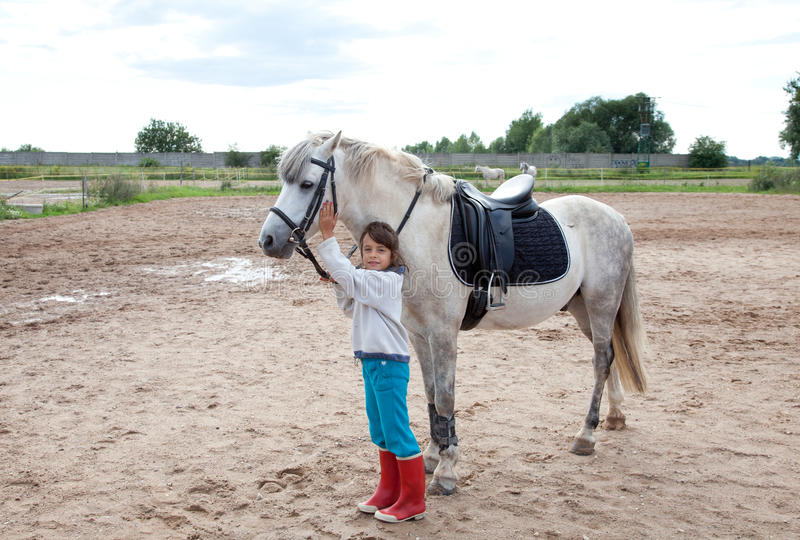 Download Little Girl Ready For A Horseback Riding Lesson Stock Photo - Image: 23597054