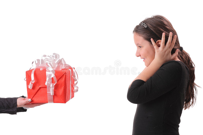 Little girl receiving a gift royalty free stock images