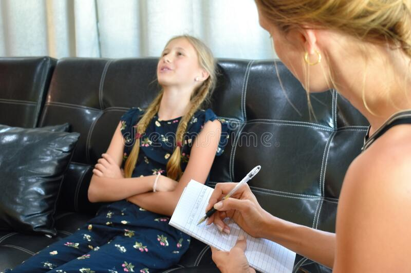 The little girl at the reception of a psychologist. A family therapist. Children`s mental therapy . royalty free stock photo