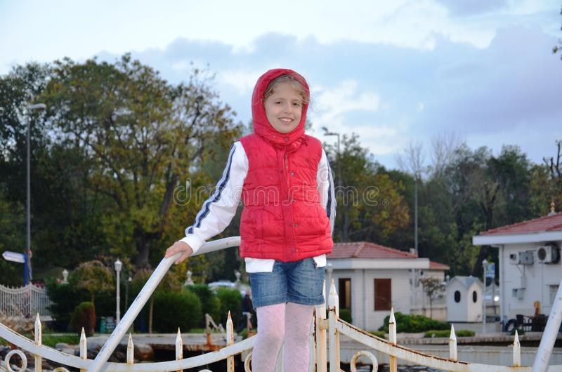 little girl in red anorakl stock photos