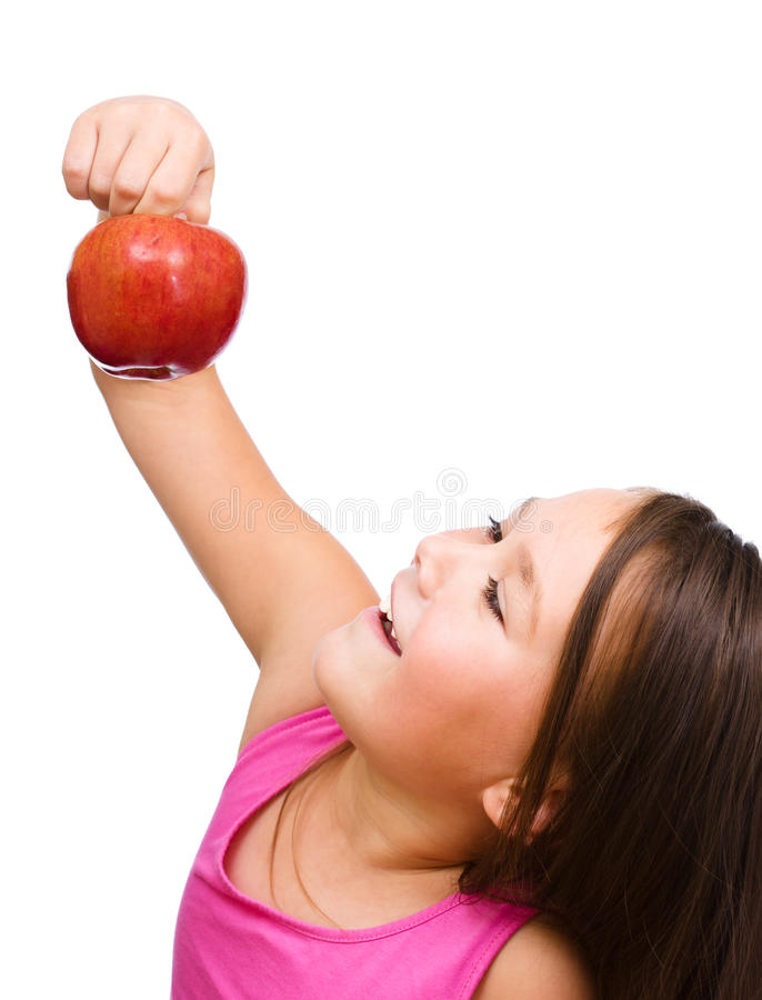 Little girl with red apple stock photography