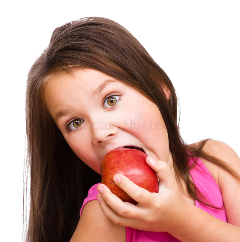 Little girl with red apple royalty free stock photography