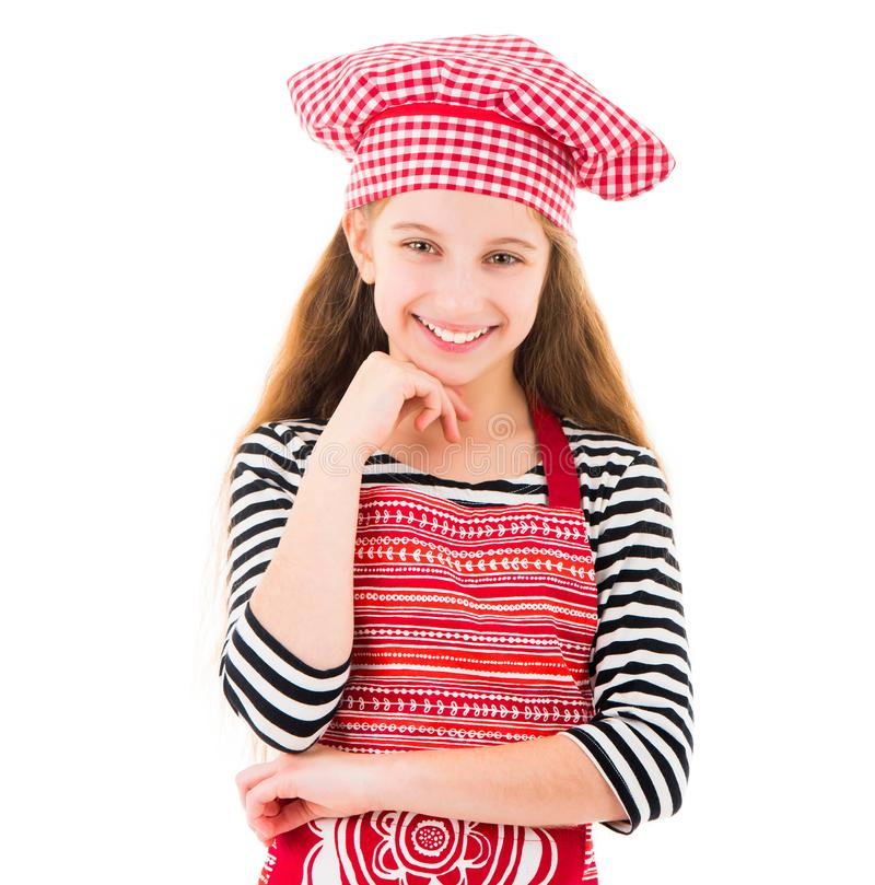 Little girl in red chef uniform smiles royalty free stock photography