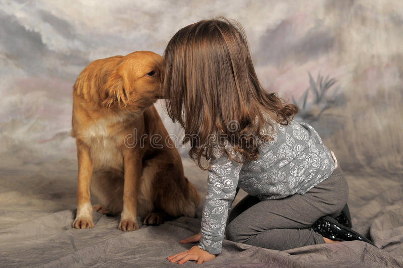 Little girl with a red dog royalty free stock photography