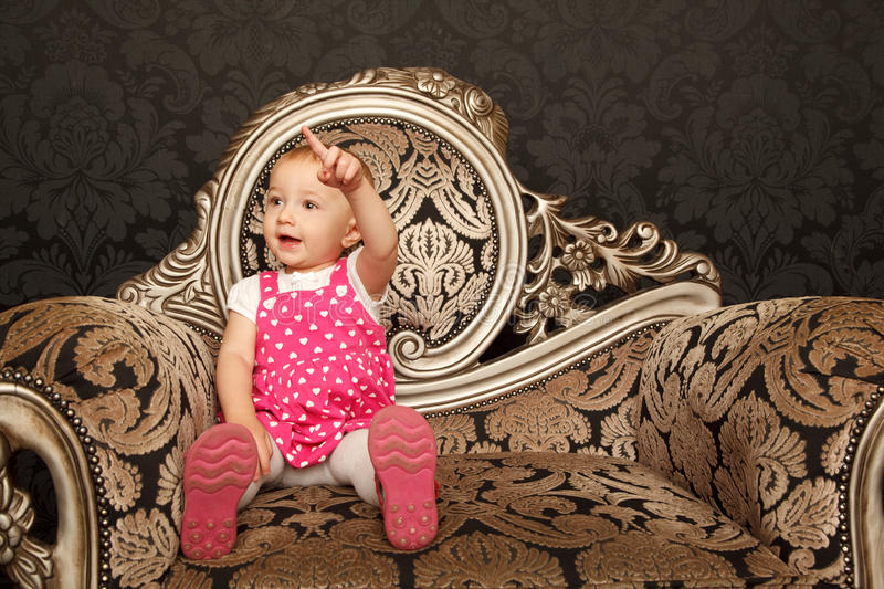 Download Little Girl In Red Dress Sitting On Retro Armchair Stock Photo - Image: 12729356