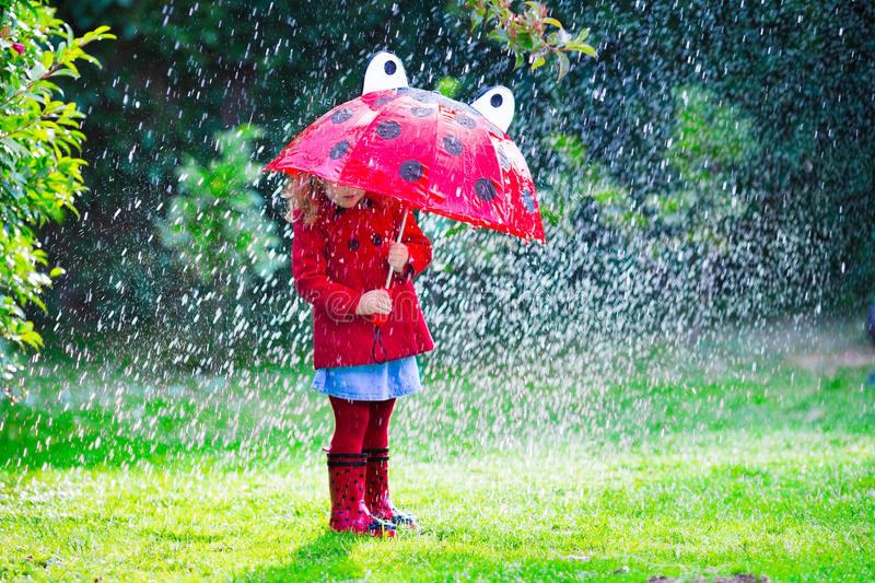 Little Girl In Red Jacket Playing In Autumn Rain Stock