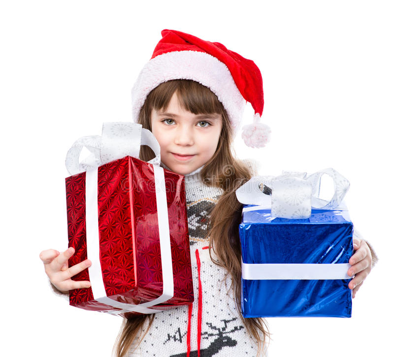 Little girl in red sana hat and gift boxes. isolated on white stock images