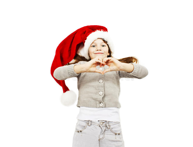 Little girl in red Santa hat making the heart with her hands stock photos