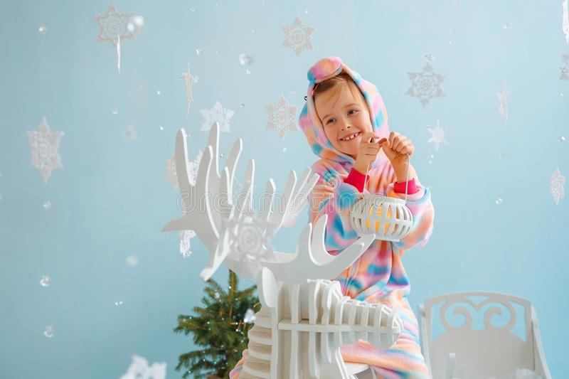 Little girl in red sneakers and Christmas deer stock photo