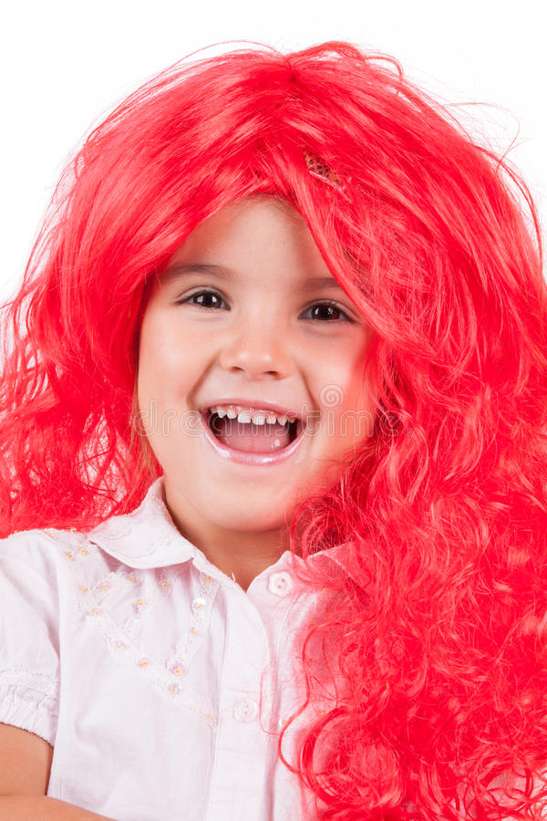 Download Little girl with red wigs stock image. Image of look - 26813495