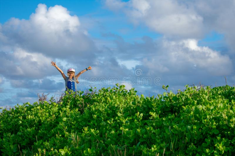 Little Girl Rejoices in Nature. A little girl rejoices in the beauty of nature royalty free stock photos