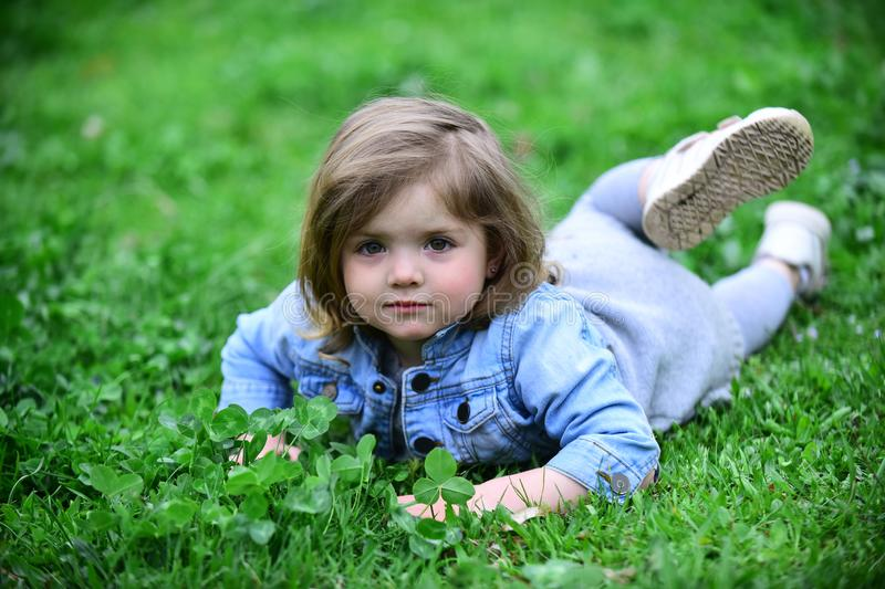 Little girl relax on spring or summer day outdoor stock photos