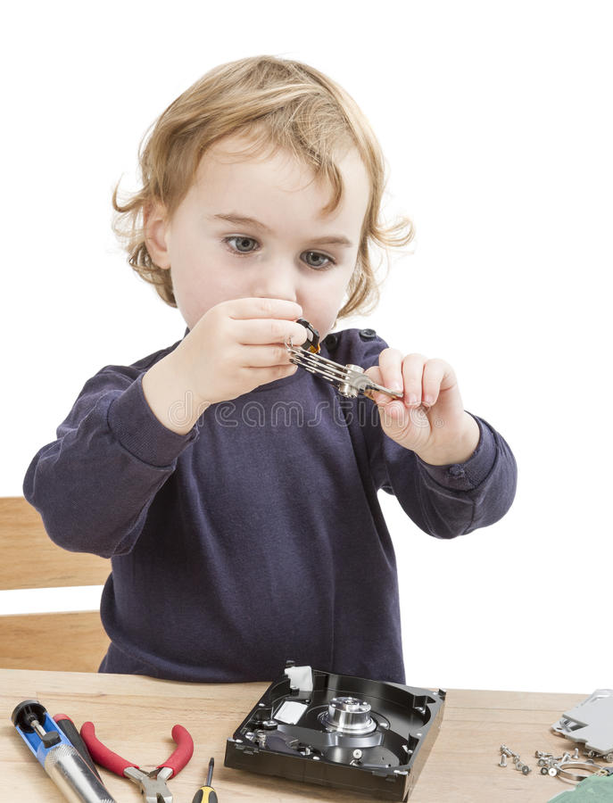 Download Little Girl Repairing Computer Parts Stock Photo - Image: 35001416