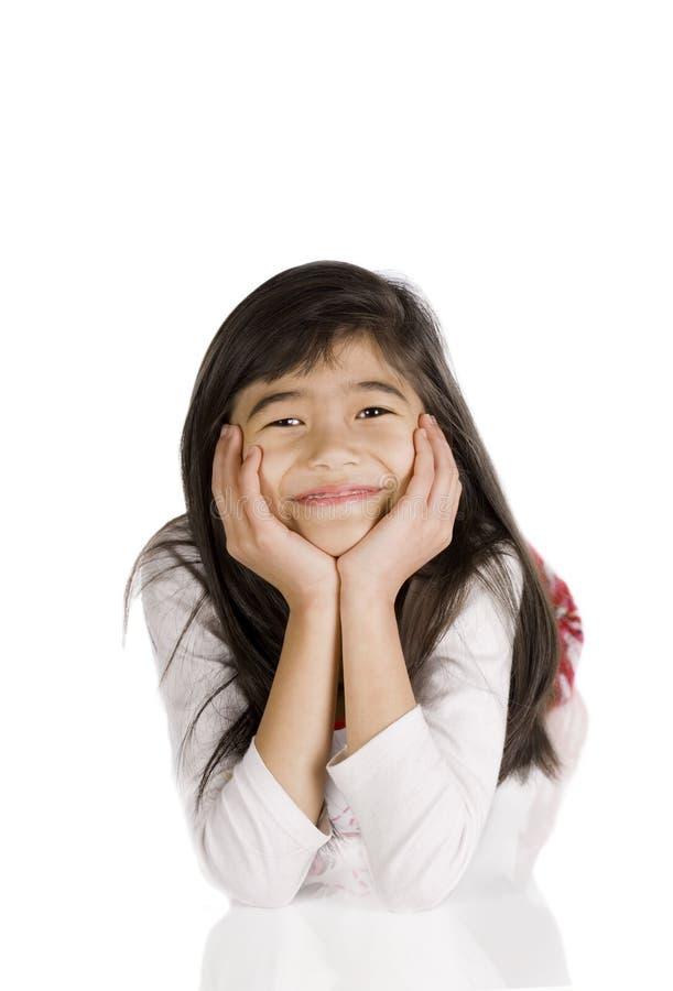 Little girl resting on floor, head on hand stock images