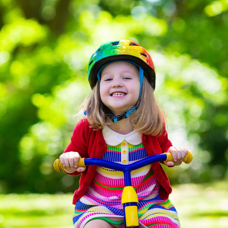 Free Little Girl Riding A Tricycle Royalty Free Stock Image - 73345566