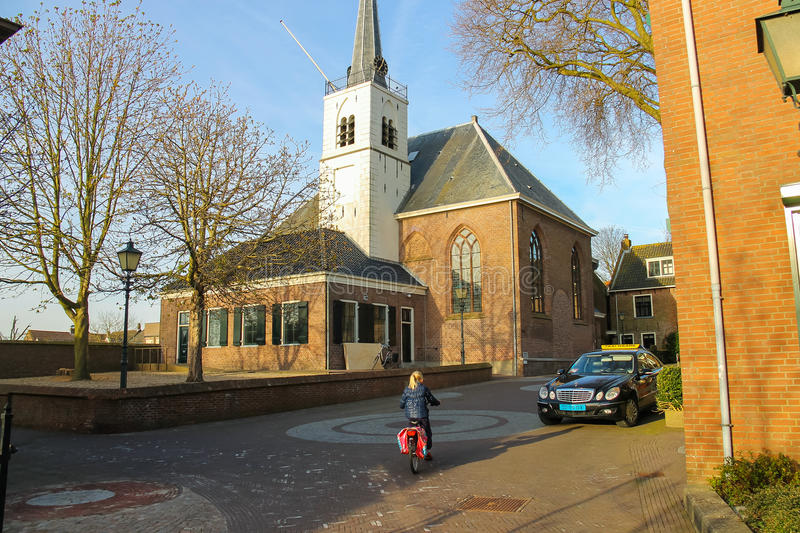 Little girl riding a bicycle in Meerkerk, the Netherlands stock photo