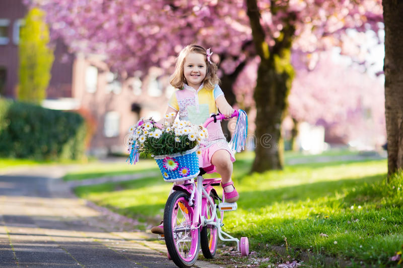 Little girl riding a bike. Child on bicycle. royalty free stock photo
