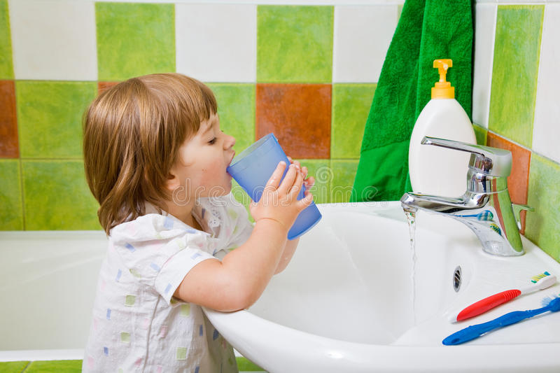 Download Little Girl Rinses A Mouth After Toothbrushing. Stock Photography - Image: 23554382